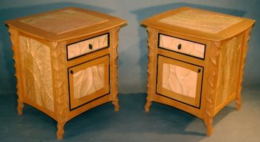A pair of carved Cherry and Birdseye Maple bedside cabinets