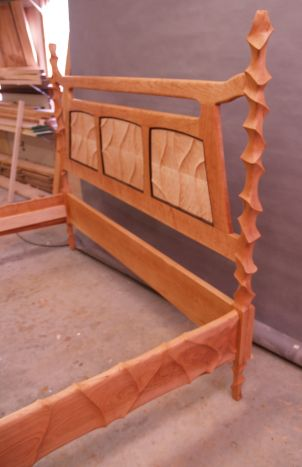 Side view of carved bed